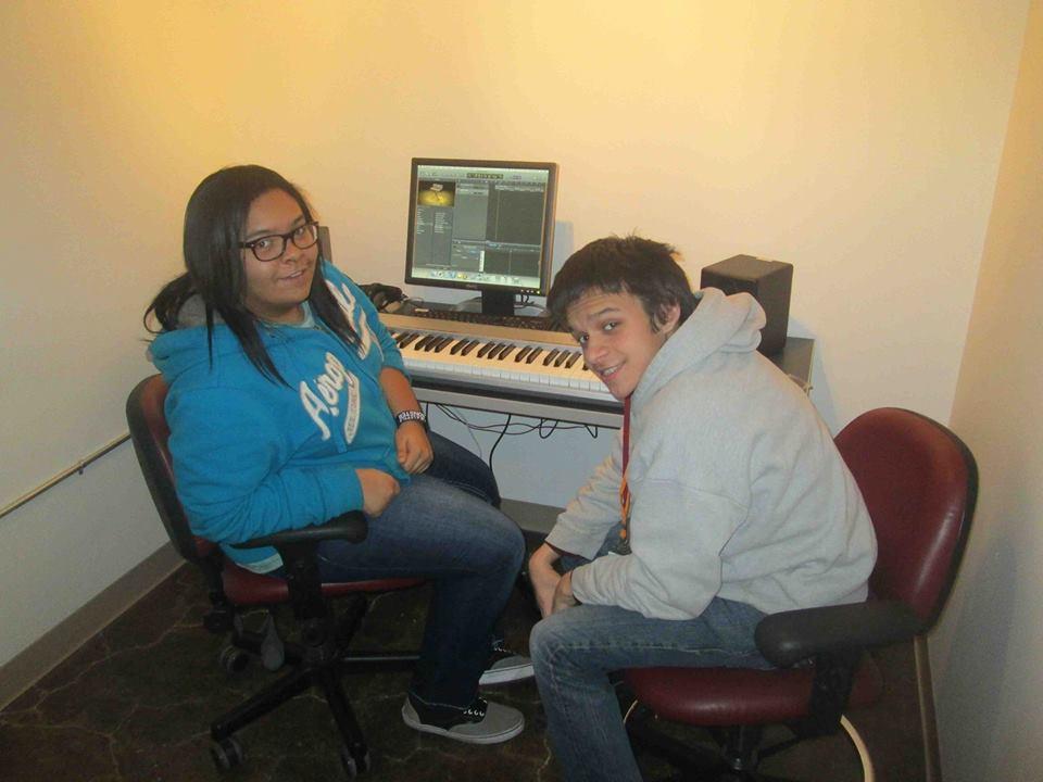 Savannah and Robbie working on her songs in IA studios in 2014